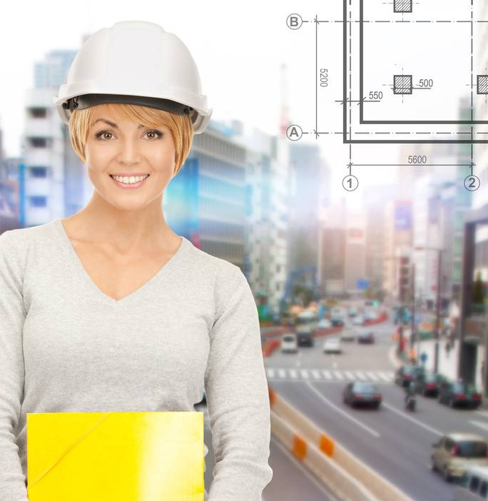 female contractor in helmet with folder